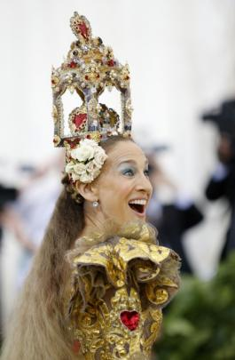 Sex and the City actress Sarah Jessica Parker opted for a gold Dolce & Gabbana gown embroidered with sacred hearts and a towering nativity scene headpiece. Photo: Reuters