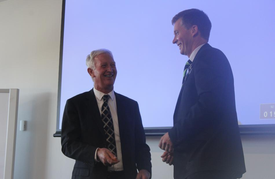 Outgoing Southland Federated Farmers president Allan Baird (right) offers his congratulations to incoming president Geoffrey Young at the Southland Federated Farmers AGM recently. Photos: Nicole Sharp