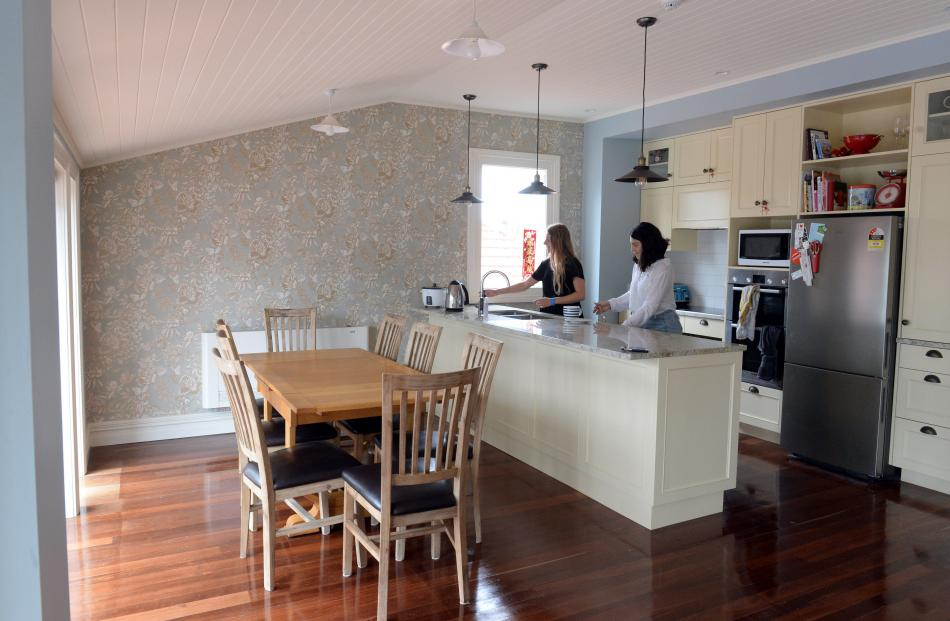 Frances Bridgman (left) and Lisa Witberg in the first-floor kitchen. The jarrah floor boards were...