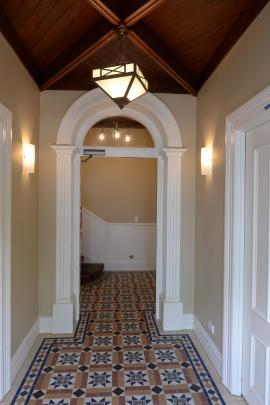 The arch and ceiling in the entrance foyer are original features. Fitting a fire-stop door...