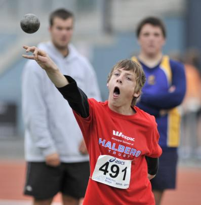Shaun  unleashes the shot at the Otago Athletics Championship at the Caledonian Ground, in...