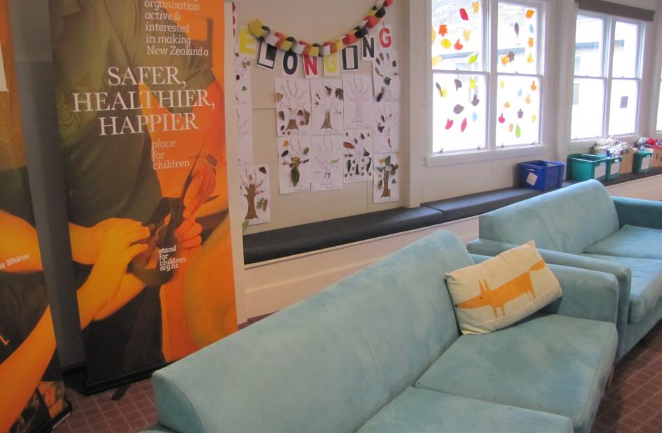 The lounge area at  Roxburgh, features artwork by children who have stayed at the village.