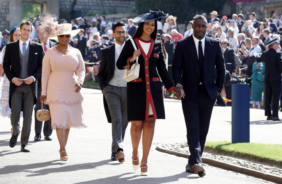 Idris Elba and Sabrina Dhowre followed by Oprah Winfrey (fourth right) arrive at St George's...