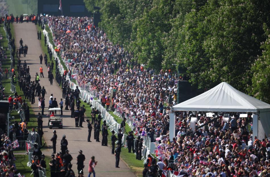 Royal fans are seen gathered along the Long Walk. Photo: Reuters