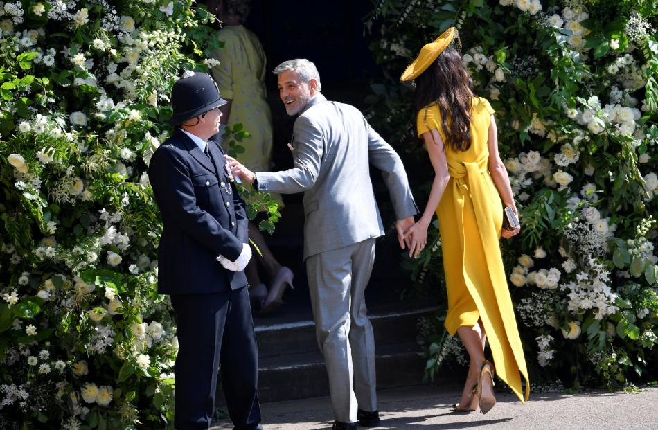 George Clooney and his wife, lawyer Amal Clooney arrive to the wedding of Britain's Prince Harry...