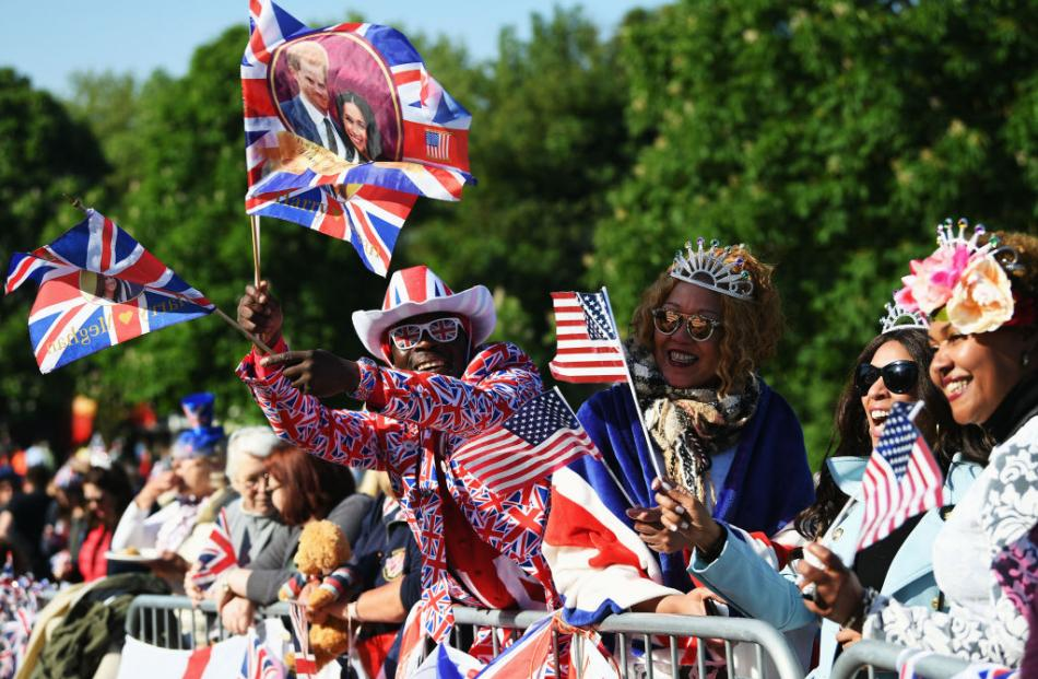 Royal fans soak up the atmopshere during the wedding of Prince Harry Harry to Ms. Meghan Markle...