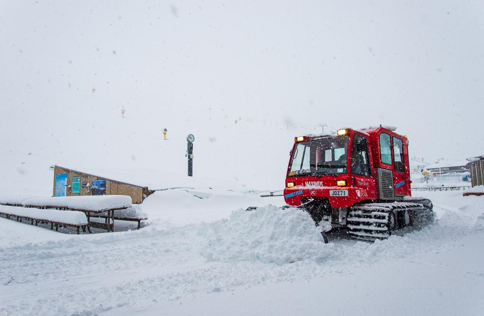 Snow plough scoops the snow at Coronet Peak ski field. Photo: Chris Hoopmann