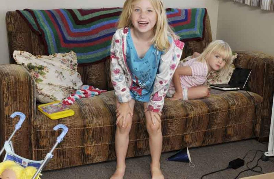 Macy (5) and Tori Hill (3), of Auckland relax at the crib.