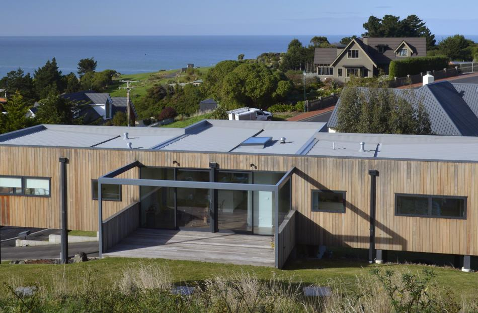 The owners of this Dunedin house wanted clean, simple lines and to capture St Clair's stunning...