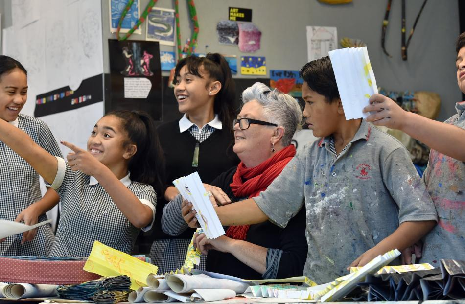 Artist Janet de Wagt (centre) works with Bathgate Park School pupils (from left) Alhaliah Puru ...