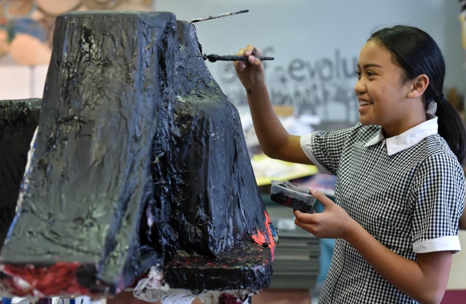 Pupil Alhaliah Puru (13) helps out by painting the boys' skateboard park.