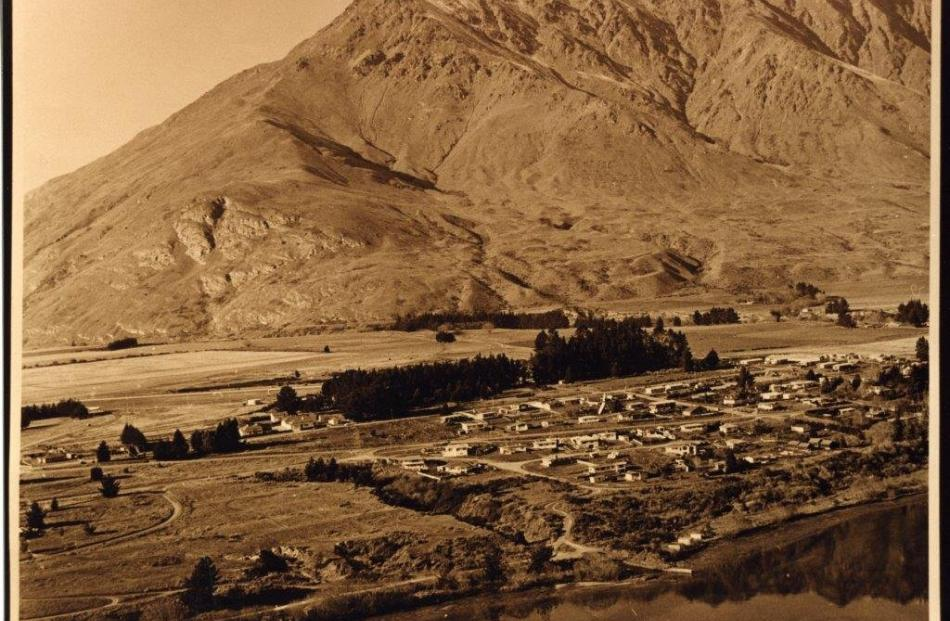 A pre-1960 view of Frankton from the air, with the Frankton Arm at bottom and the Remarkables at back. Photos: Lakes District Museum