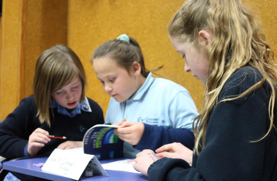 Cromwell Primary School pupils (from left) Mella Stevenson (11), Gabby Sanders (10) and Ella Anderson (10) whizz through the dictionary round.