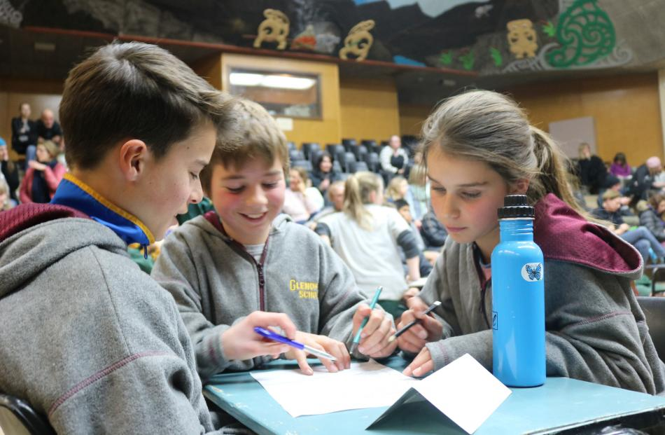 Glenorchy Primary team (from left) Harley Davies (13), Sam Glover (12) and Ruby Davies (11) put their heads together to come up with the answer. Photos: Tom Kitchin