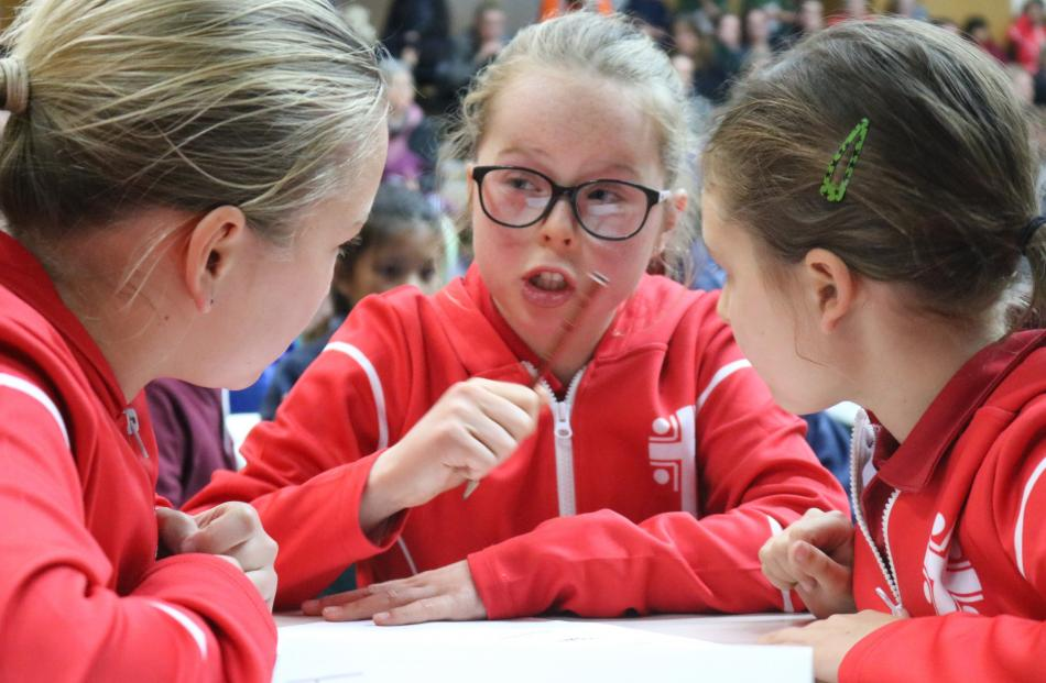 Annie Dowling (centre) suggests a way forward to teammates Alivia Steele (left) and Grace Farquhar (all 10), all from St John's School team, of Ranfurly.