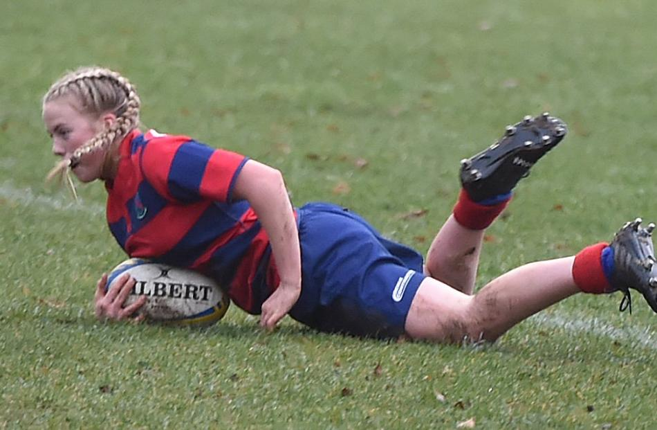 Lily Pringle (13), of South Otago High School, scores against Taieri College at Logan Park last Wednesday
