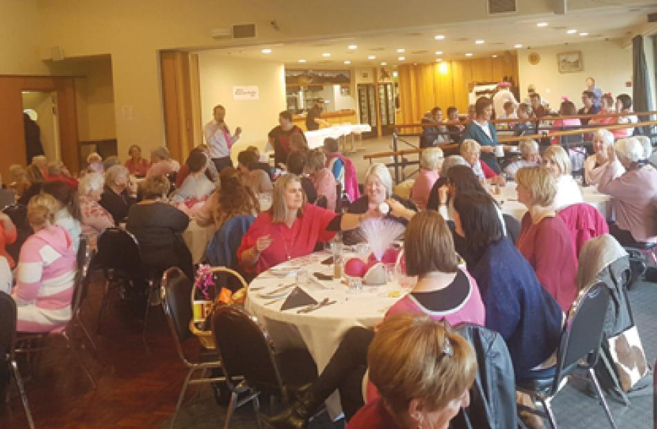 People enjoy the Te Anau Pink Ribbon Breast Cancer Awareness and Fundraising Breakfast in the Te...