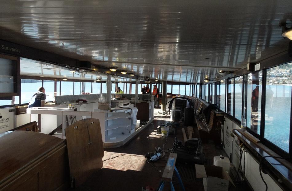 Contractors fit  the  new cafe/bar on the  promenade deck.