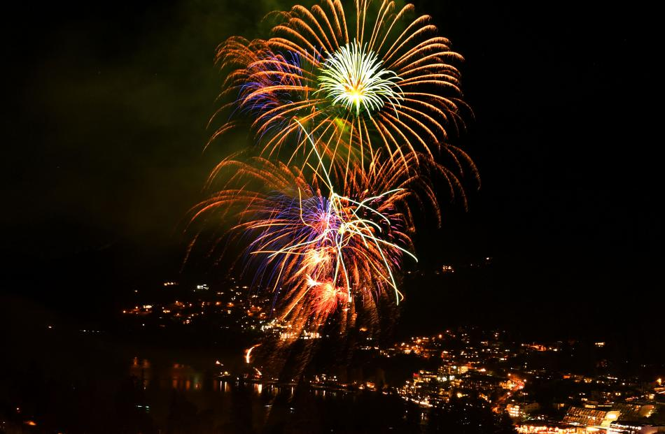 The fireworks display lights up Queenstown last night.
