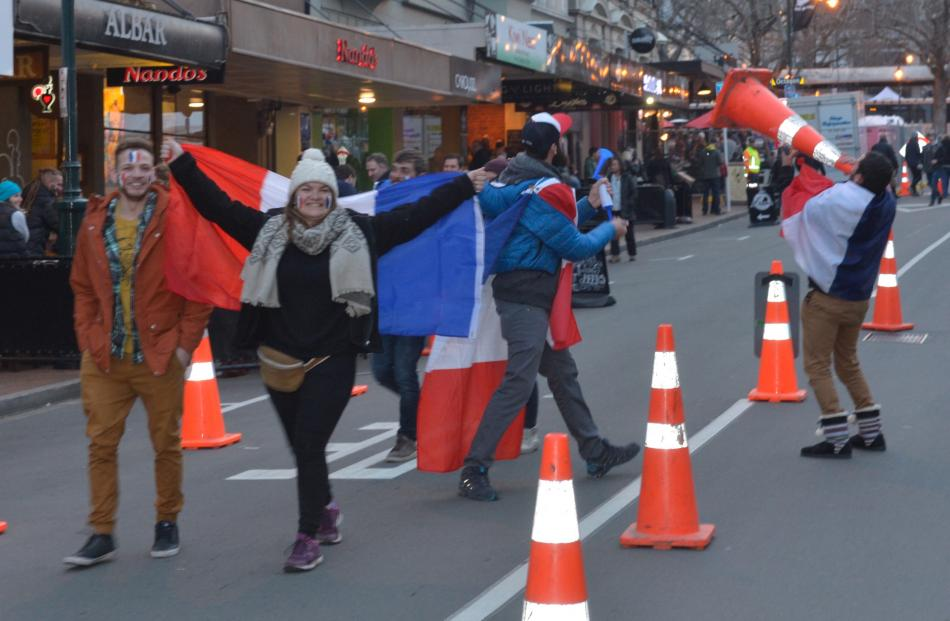 French supporters make their way noisily down Stuart St on their way to the test. Photo: Gerard O...