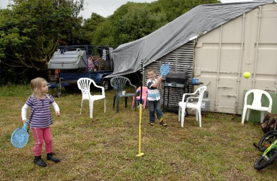 Clair and Ben Wild (4), of Dunedin, play outside their makeshift holiday home at Aramoana.