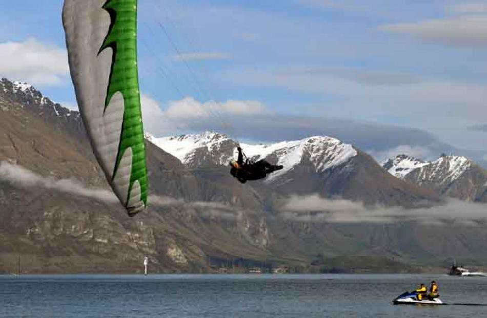 In-coming . . . Parapenter Dan Stephens, from Queenstown, puts on a show as he entertains the...