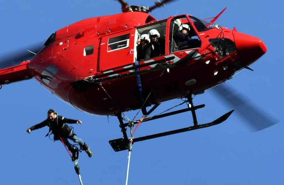 Leap of faith . . . Using a cord he made himself, AJ Hackett Bungy employee Quinn Gardiner jumps...