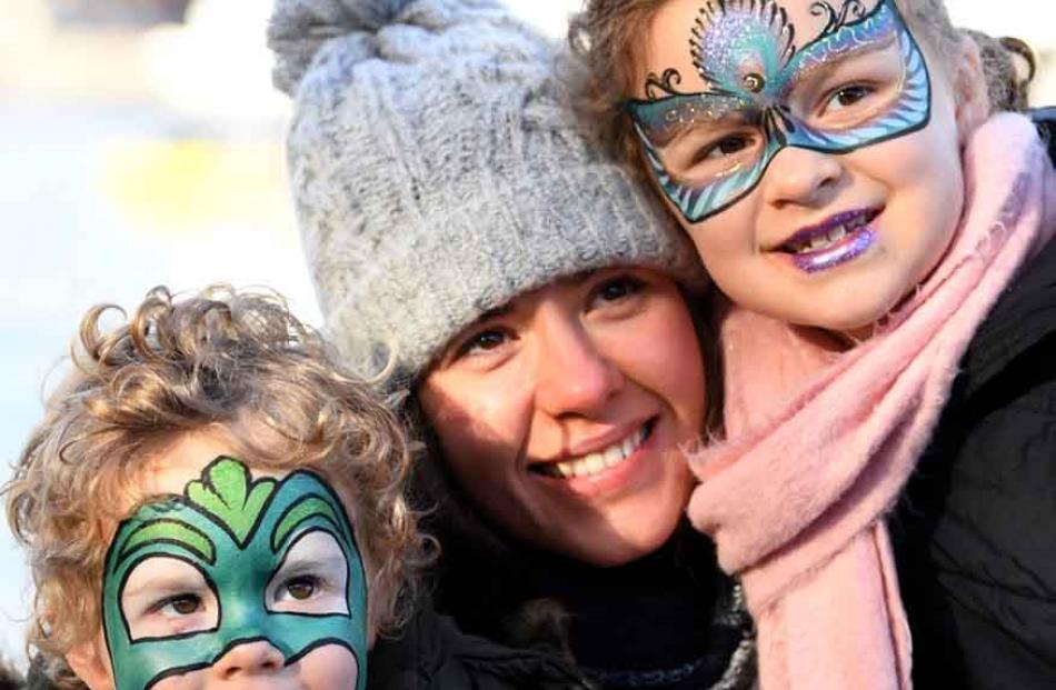 Eyes on the fun . . . Brisbane family James (2), Tenealle, and Olivia (7) Culhane watch the...