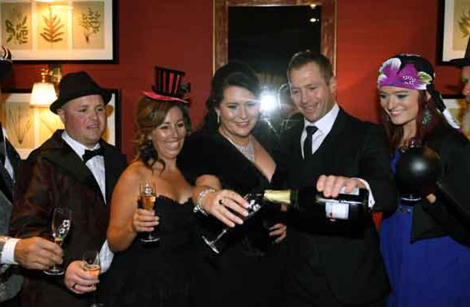 Lets have a ball . . . Having pre Skycity Ball drinks on Friday night at the Sofitel are (from...