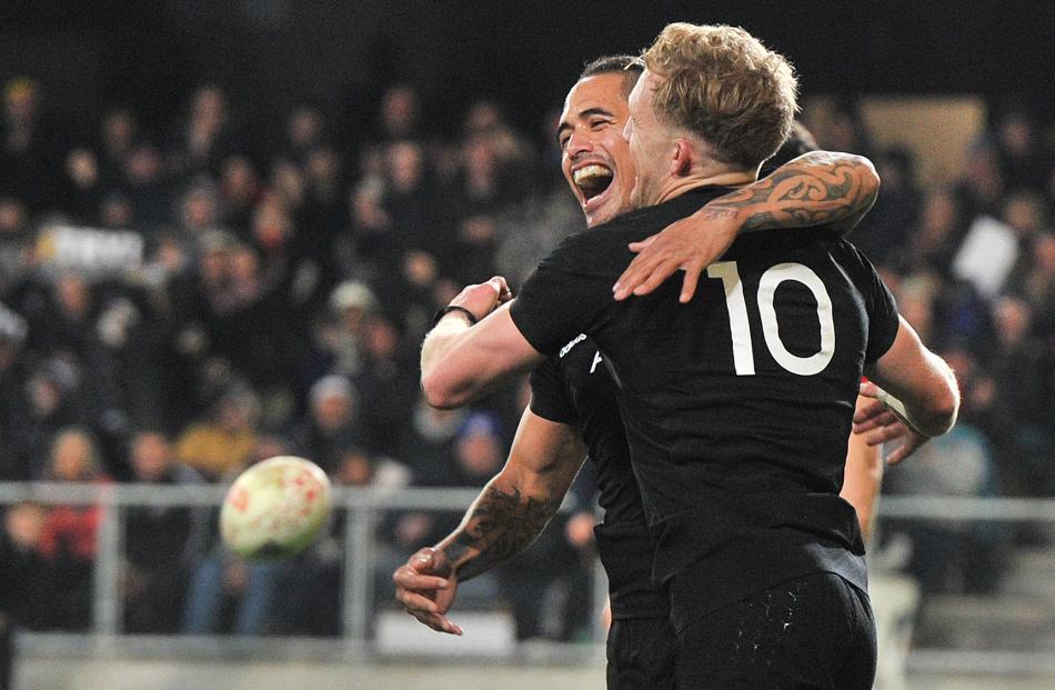 All Blacks Aaron Smith  and Damian McKenzie celebrate  a try.