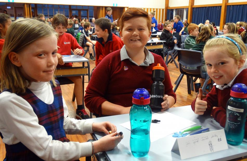 St Joseph's Timaru pupils (from left) Rose Doran (9), Lui Tupola (10) and Ruby Laming (9) put...