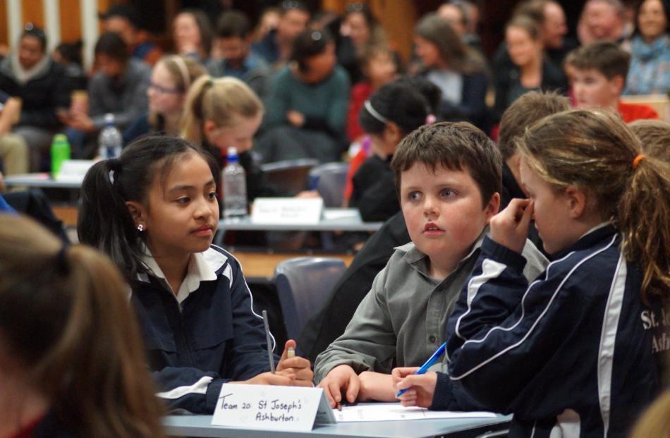 St Joseph's Ashburton pupils (from left) Sophia Aguila (11), Brendan McCrea (10) and Phoebe...