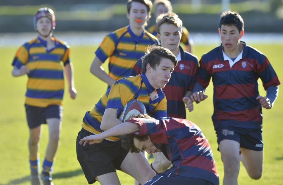 Tyson Kavanagh - Moore (Tokomairiro High School) tries to break the Kavanagh College defence...