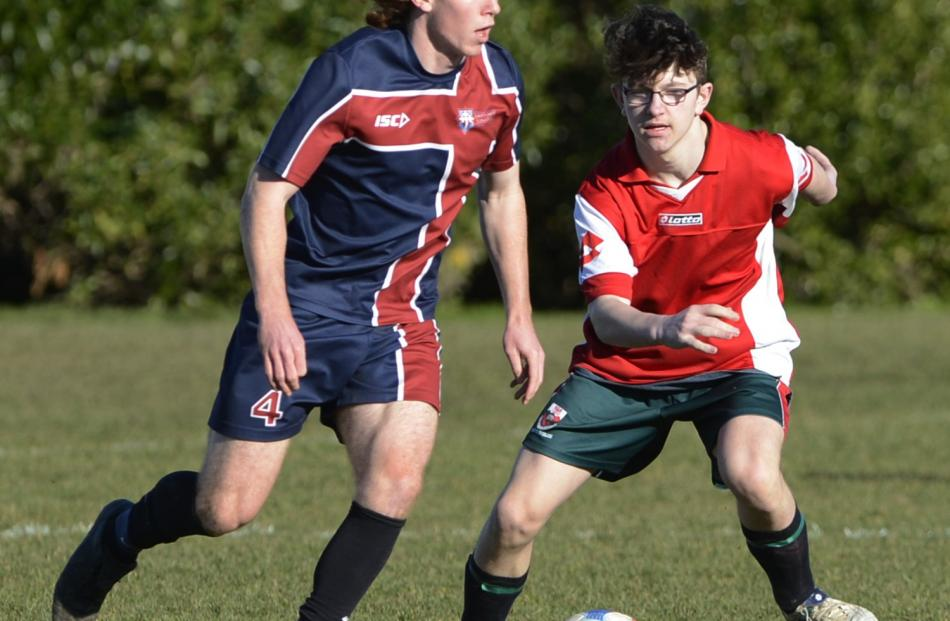 Tim O'Farrell (Kavanagh College) is challenged by Riley Dasler (Kaikorai Valley College) during a...