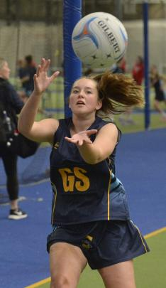 Taieri College goal shoot Jaci Lambie reels in a pass during a netball match against Kavanagh...