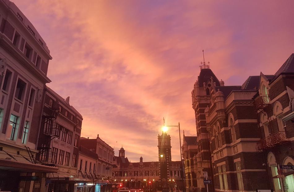 The sun rises over the Dunedin Railway Station. Photo: Vaughan Elder