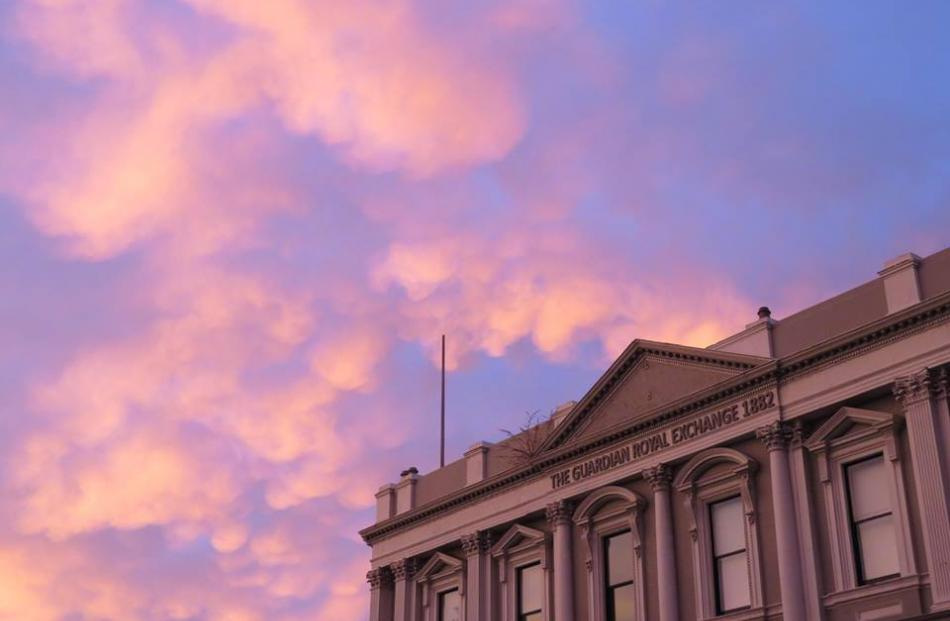 Pink clouds float over The Exchange in Dunedin. Photo: Caz Rickerby