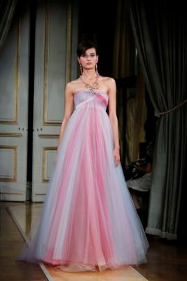 The Armani show featured champagne-coloured touches for its latest collection, reflected in satin adornments and linings or the figure-hugging long skirts. Photo: Reuters