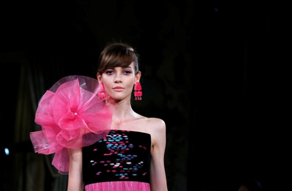 The Armani Prive collection also featured splashes of turquoise pink and fuschia, with some entirely pink, glitzy looks rounding off the presentation. Photo: Reuters