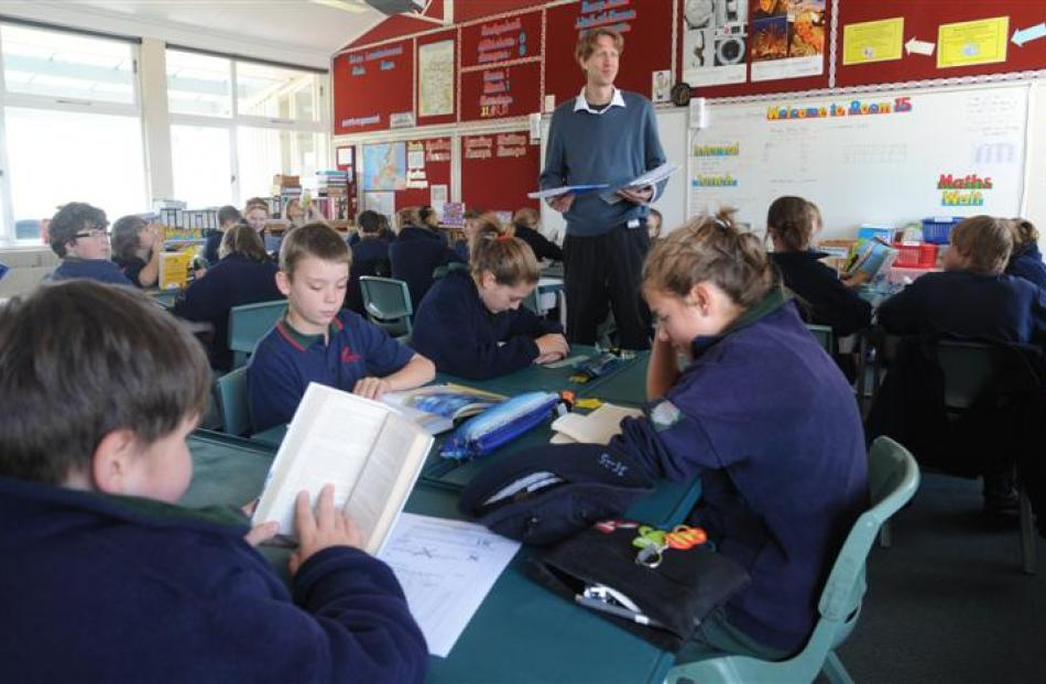 David Owen has some quiet time with his year 8 class on the first day back at school.
