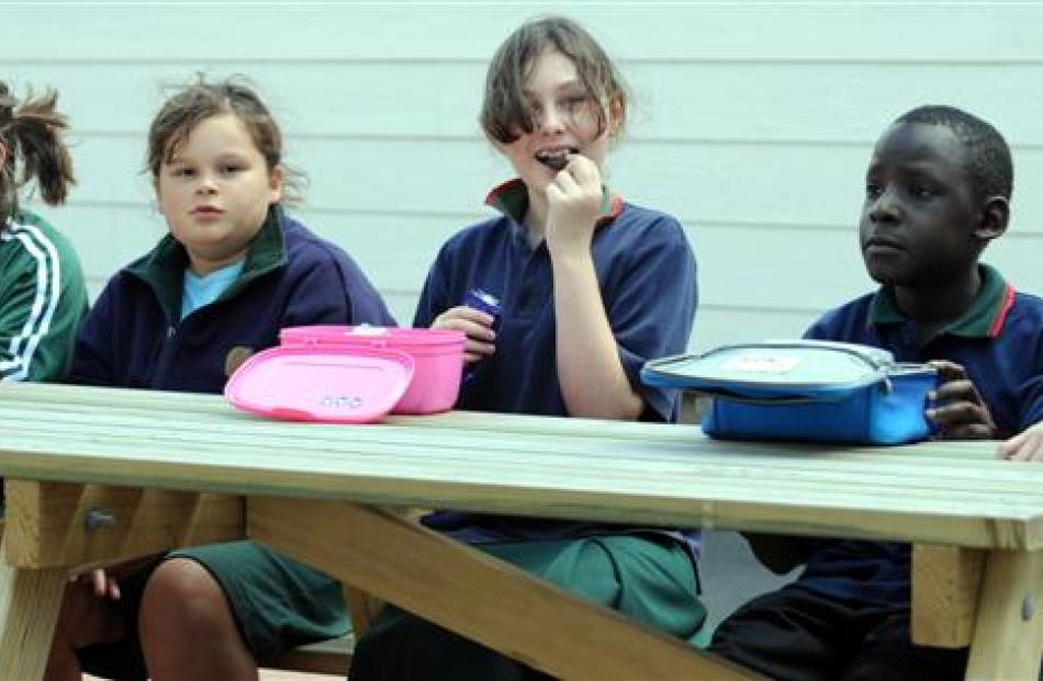 Tucking into lunch on the first day back at school are (from left) Britten Clarke (10), Samantha...