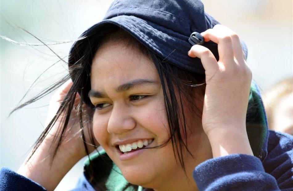 Waimirirangi Pohatu (12) holds on to her hat.