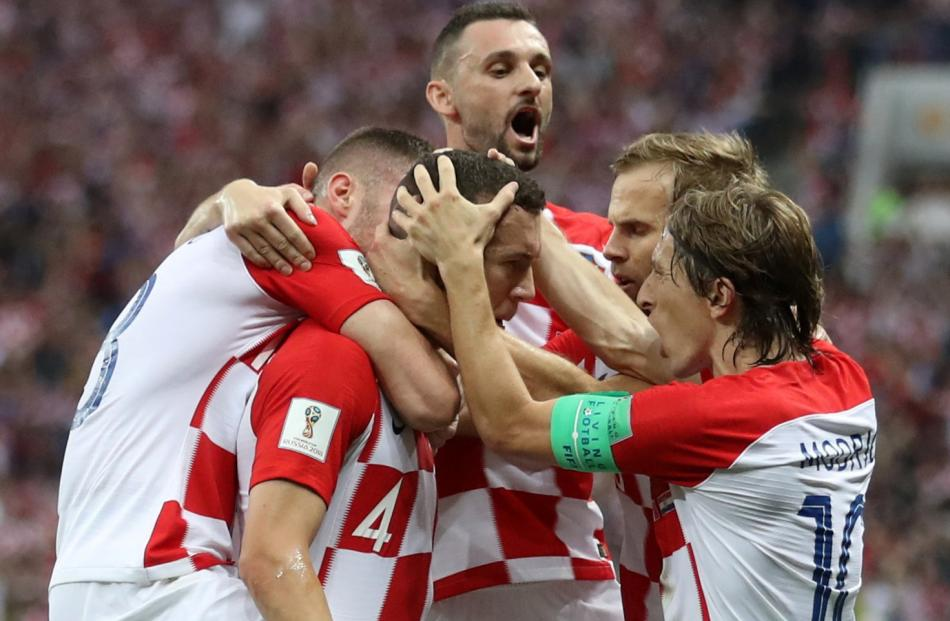 Croatia's Ivan Perisic celebrates scoring their first goal with team mates. Photo: Reuters
