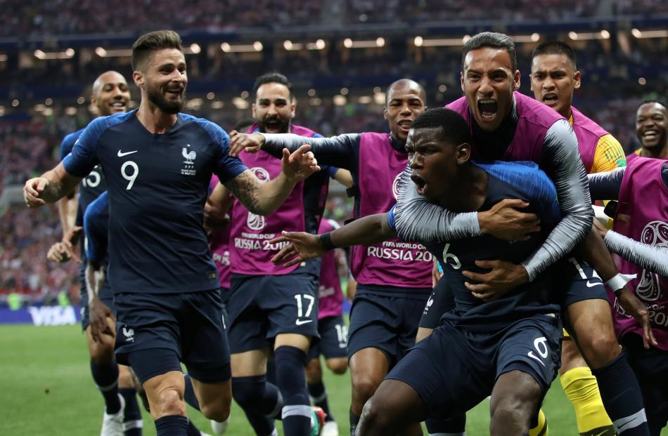 France's Paul Pogba celebrates scoring their third goal with team mates. Photo: Reuters
