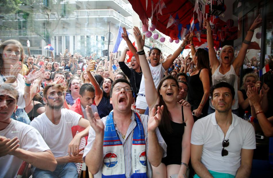 France fans watch France v Croatia in Paris. Photo: Reuters