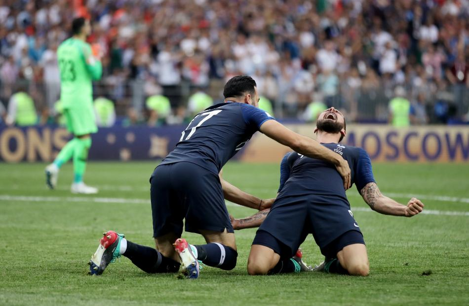 France's Olivier Giroud and Adil Rami celebrate winning the World Cup. Photo: Reuters