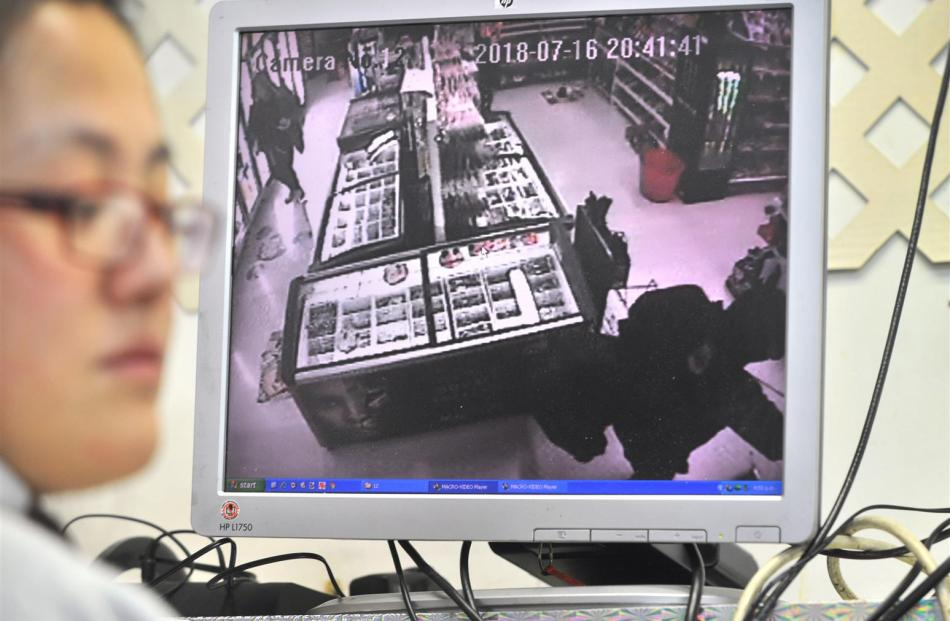 Elgin Food Market owner Sunny Sun with the CCTV footage showing the masked man and woman who...