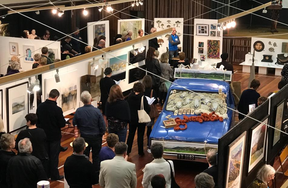 Art lovers perusing the art at Friday evening gala opening. Photos: Supplied
