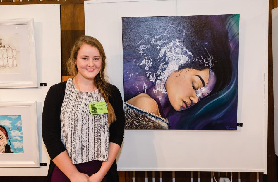 """Ruth Crouchley (21), of Te Anau, with her winning piece """"Legend of the Lake""""."""