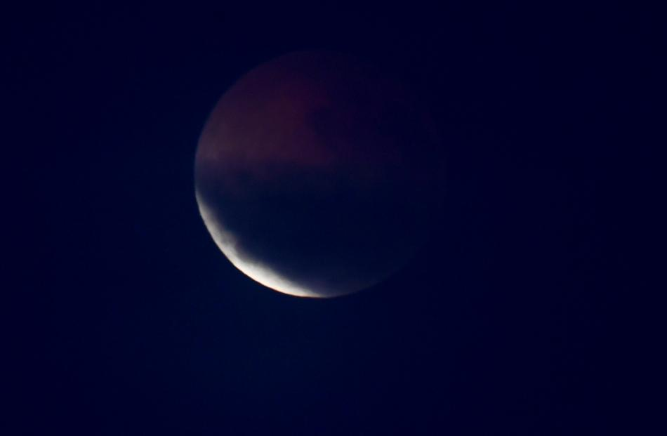 The moon before it appeared 'blood red&#039 over Dunedin this morning